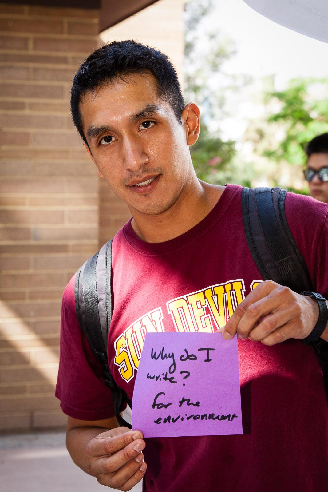 """Image: Students at ASU's celebration of the 2015 National Day on Writing articulated their thoughts on """"Why I Write."""" This student discussed how writing helped his advocacy aims. / Photo by Bruce Matsunaga"""