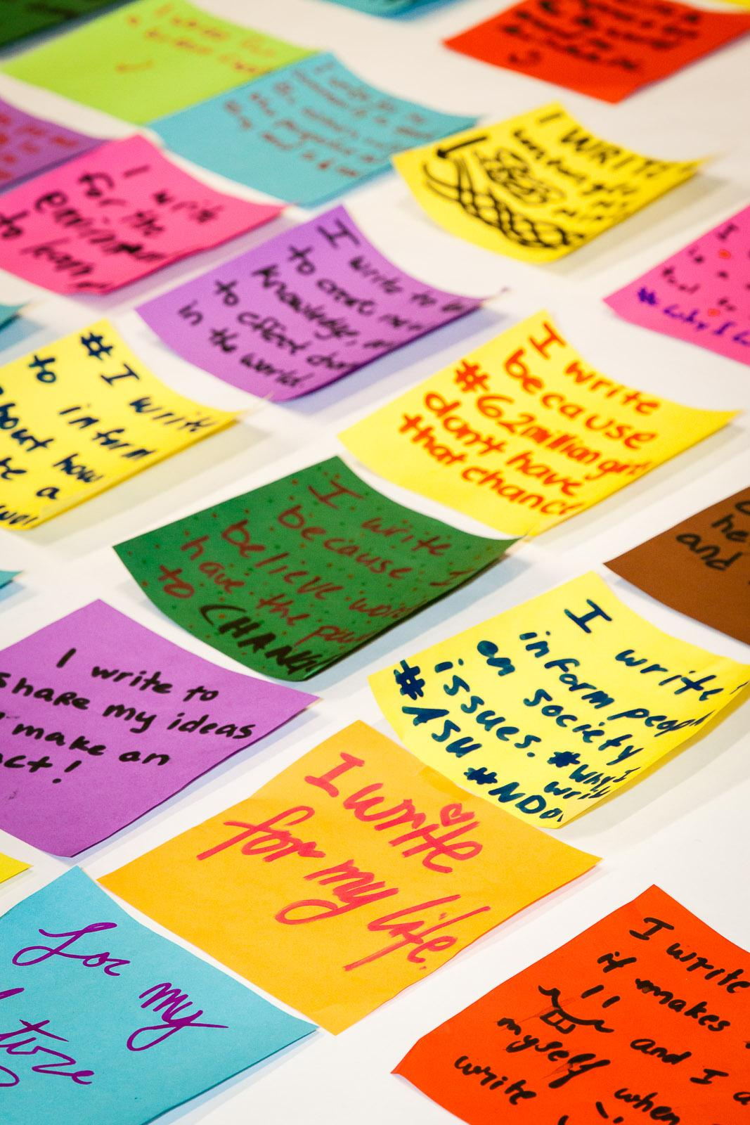 """Image: Participants in ASU's celebration of the 2015 National Day on Writing articulated their thoughts on """"Why I Write"""" on squares of origami paper, which were later assembled in a colorful """"quilt."""" / Photo by Bruce Matsunaga."""